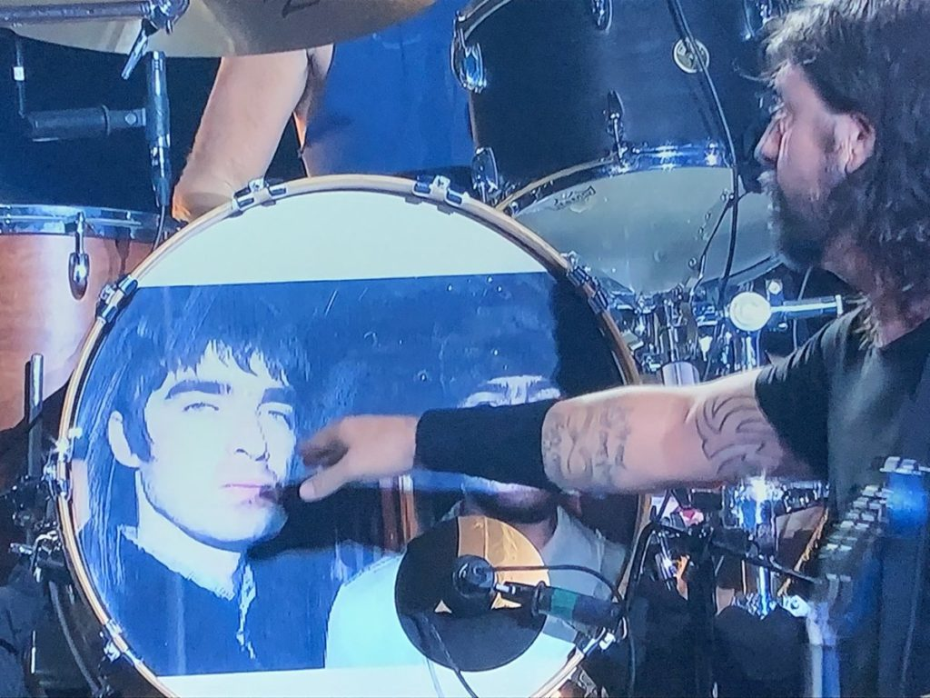 Foo Fighters decorate the drum kit with a 1995 photo of Noel and Liam